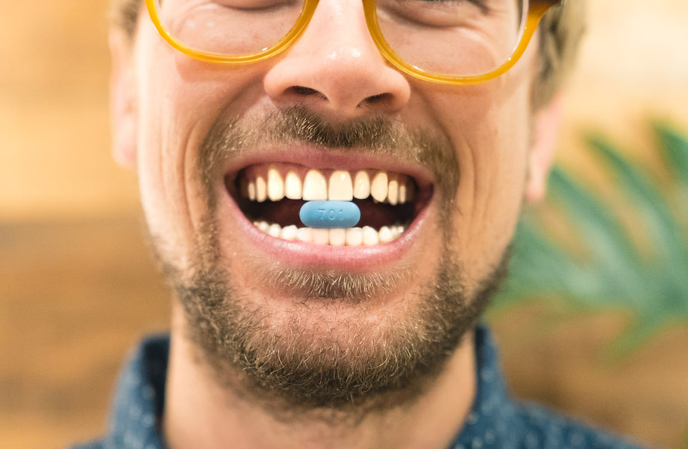 man with prep truvada pill in mouth