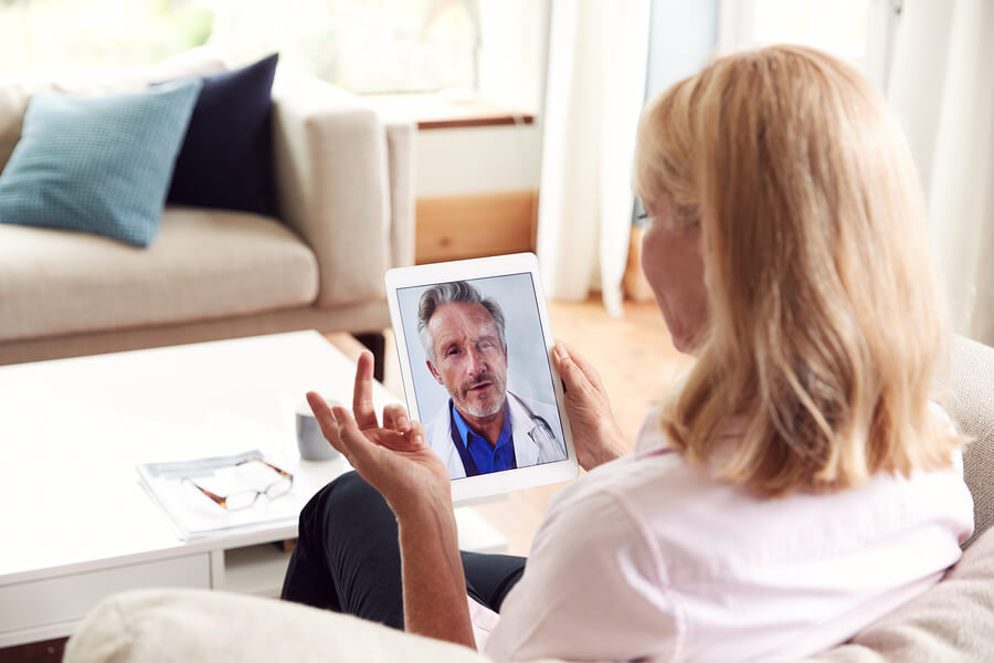 A woman talking to an online doctor on an ipad about getting anxiety medications online.